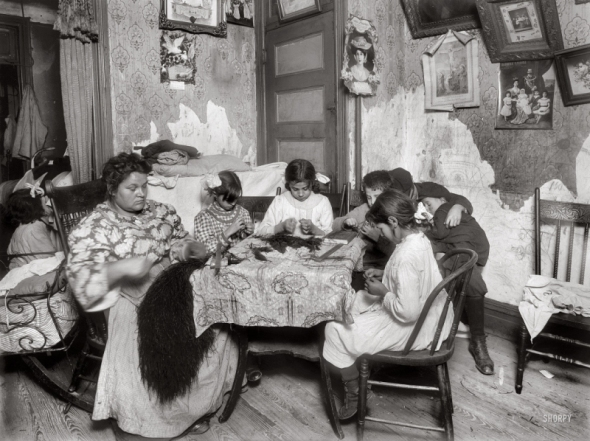 "New York. December 1911. ""5 p.m. Mrs. Mary Mauro, 309 E. 110th St., 2nd floor. Family works on feathers (sewing them together for use as a hat trimming). Make $2.25 a week. In vacation two or three times as much. Victoria, 8 yrs. Angelina 10 yrs. (a neighbor). Frorandi 10 yrs. Maggie 11 yrs. All work except two boys against wall. Father is street cleaner and has steady job. Girls work until 7 or 8 p.m. Once Maggie worked until 10 p.m."""