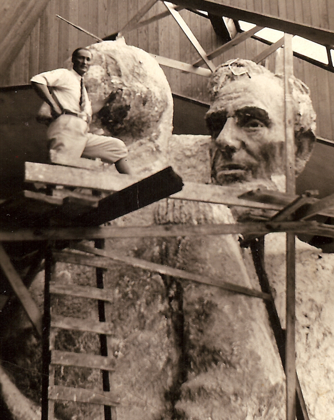 Luigi Del Bianco in Gutzon Borglum's studio at Mount Rushmore with the models for George Washington and Abraham Lincoln. Notice the torso and full dress on Washington; Borglum had originally planned to make Rushmore more than just the four faces, but lack of funding, skilled laborers and faulty rock precluded that. (Photo courtesy of Del Bianco Family Collection)